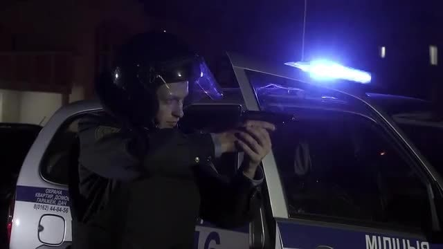 Police Officer In Position: Stock Video