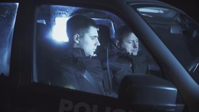 Police In Squad Car: Stock Video
