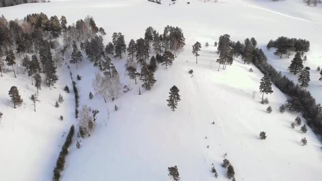 Flying Over Hill In Winter: Stock Video
