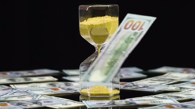 Banknotes And Hourglass: Stock Video