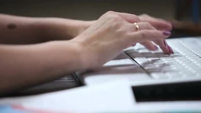 Woman Typing On Laptop: Stock Video