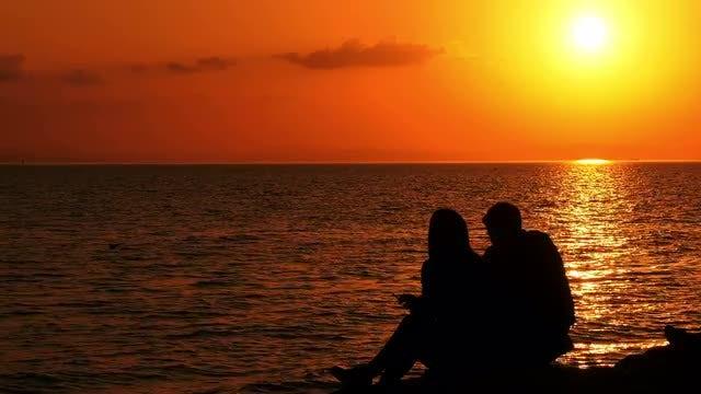 Couple Sitting On Seaside: Stock Video