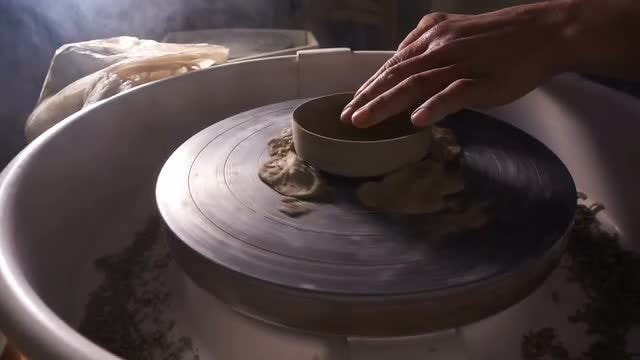 Potter Shapes Piece Of Clay: Stock Video