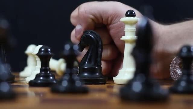 Punch On The Chessboard: Stock Video