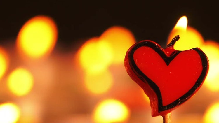 Heart-Shaped Candle: Stock Video