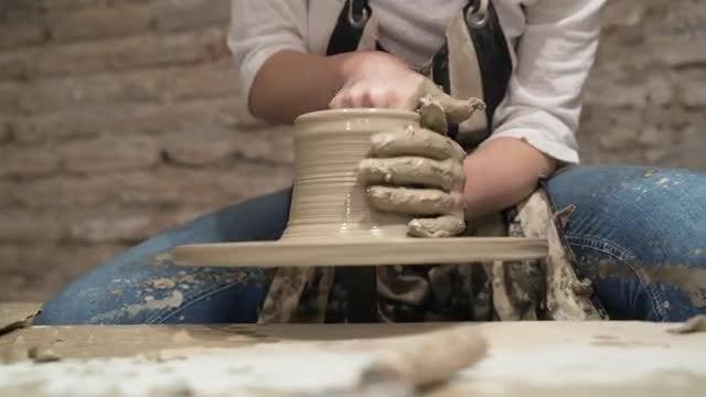 Female Potter Making A Pot: Stock Video