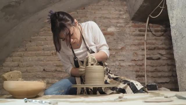 Girl Making A Clay Jar: Stock Video