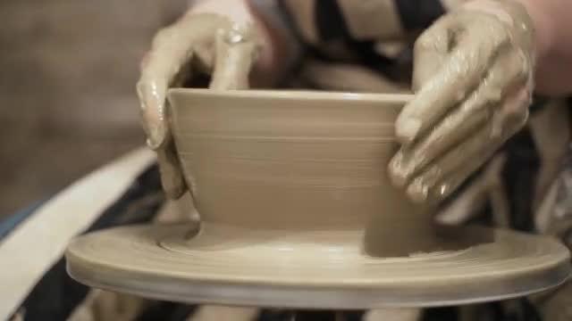 Potter Destroys Clay Jar: Stock Video