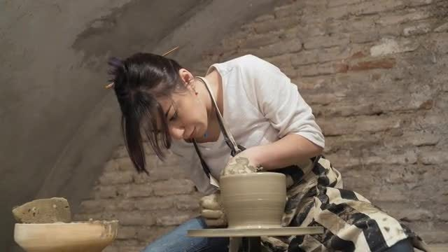 Girl Potter At Work: Stock Video