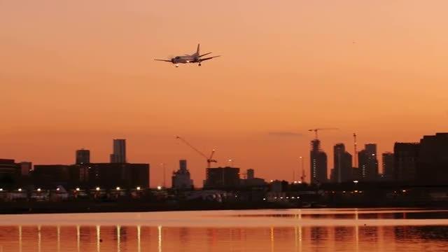 Airplane Landing At Sunset: Stock Video