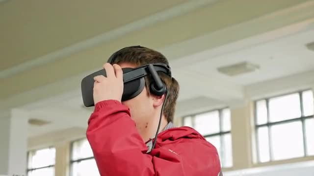 Teenager Wears VR Headset - Stock Video | Motion Array