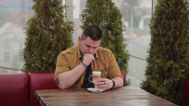 Thoughtful Man Drinking Latte: Stock Video