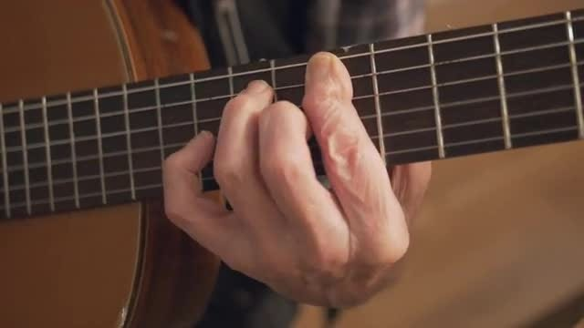 Senior Man Hands Playing Guitar: Stock Video