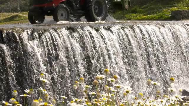Truck Passes Over A Waterfall: Stock Video