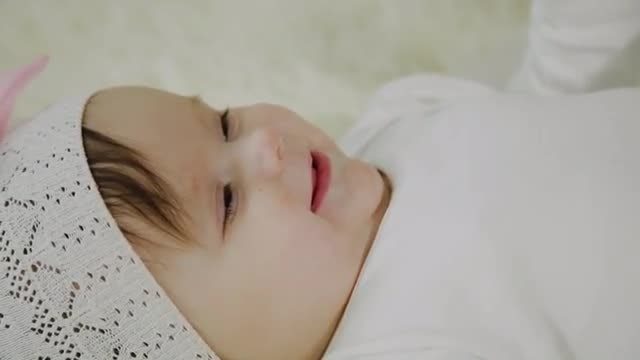 Laughing Baby Girl Lying Down: Stock Video