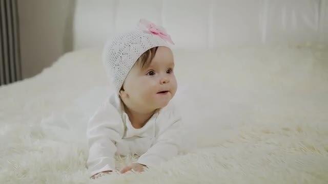 Prone Baby Lies Down: Stock Video