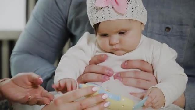 Baby Bites Mom's Finger: Stock Video