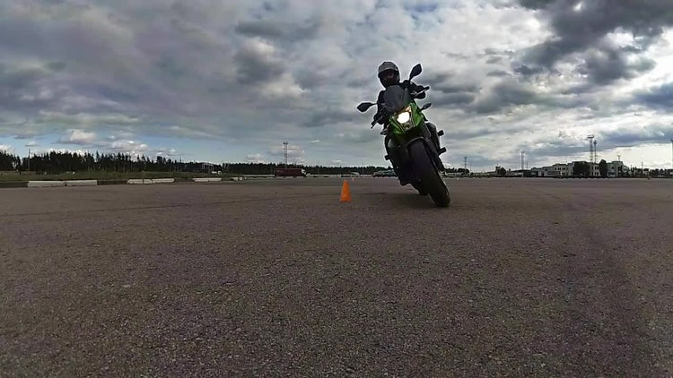 Motorcyclist Rides On Camera: Stock Video