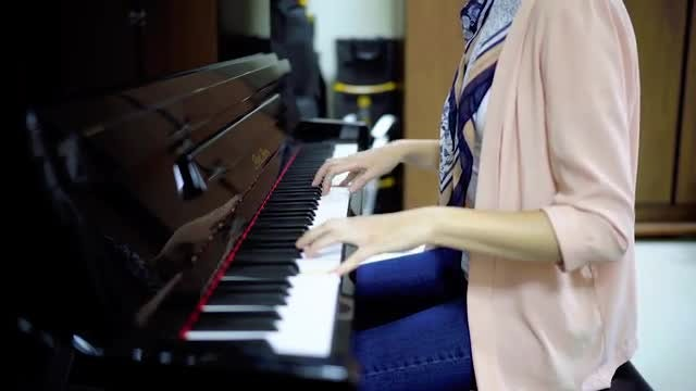 Woman Playing Piano: Stock Video