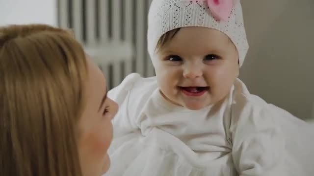 Mom And Baby Smile: Stock Video