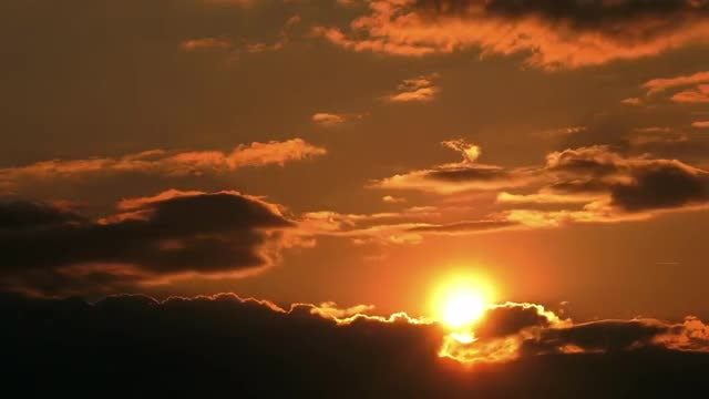 Sun Behind Dark Clouds: Stock Video
