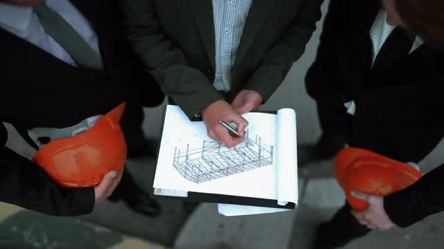 Architect Presents Building Plan: Stock Video