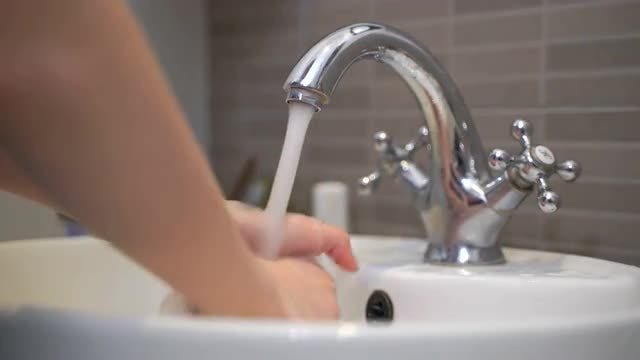 Girl Washes Her Hands: Stock Video