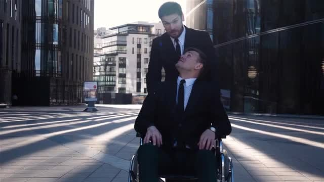 Disabled Businessman With Colleague: Stock Video