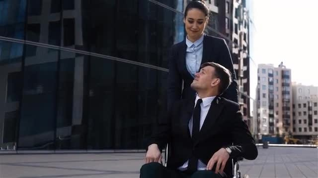 Woman Helps Disabled Businessman: Stock Video