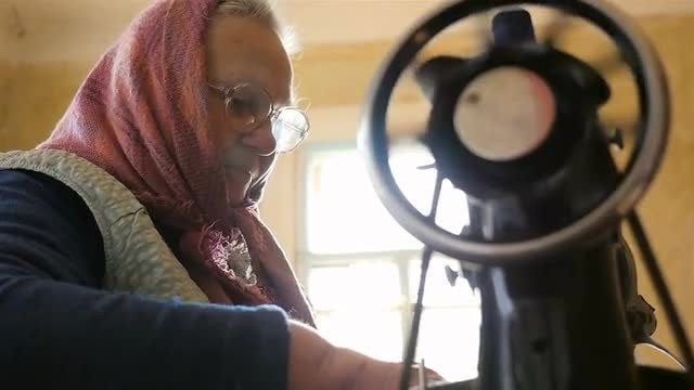 Woman Sewing At Home: Stock Video