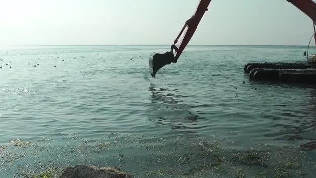 Excavator Digging The Sea: Stock Video