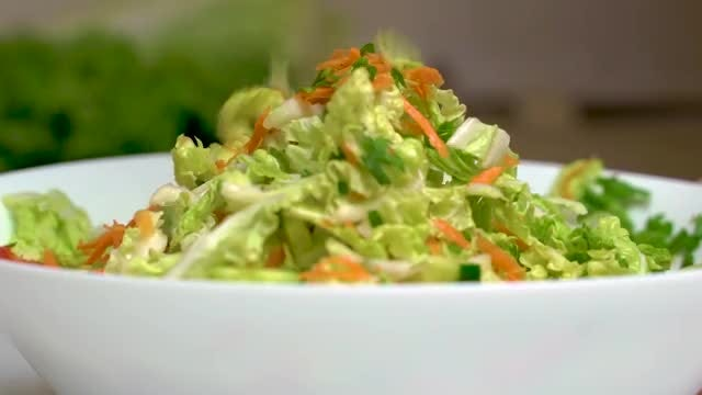 Mixing A Salad: Stock Video