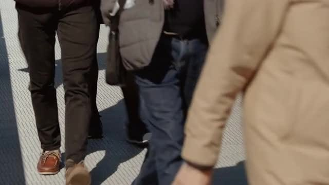 People Crossing A Bridge: Stock Video