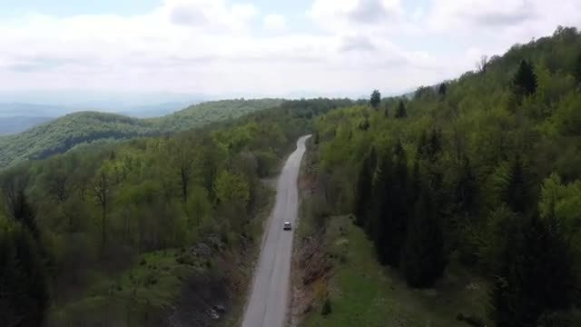 Cars Driving Through Mountain Road: Stock Video