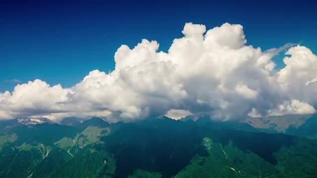 Time Lapse Clouds Over Peaks: Stock Video