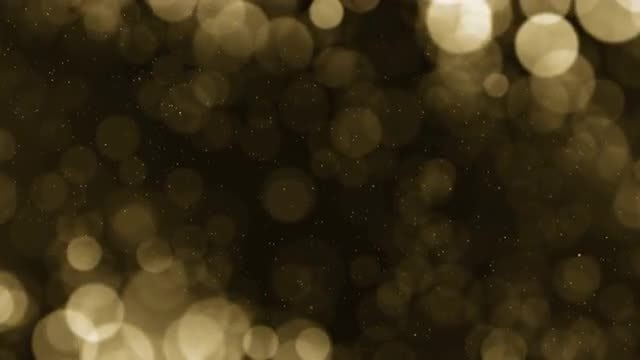 Gold Particles Background Loop: Stock Motion Graphics