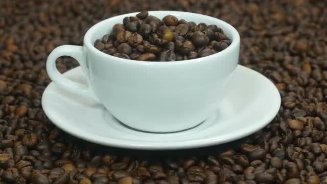 Cup With Coffee Beans: Stock Video