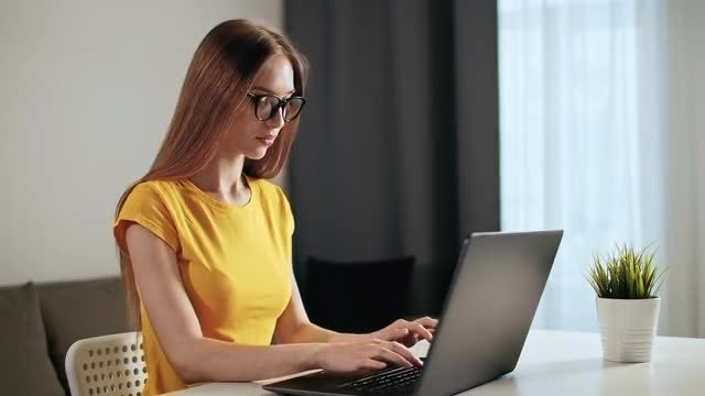 Woman Works On Laptop: Stock Video