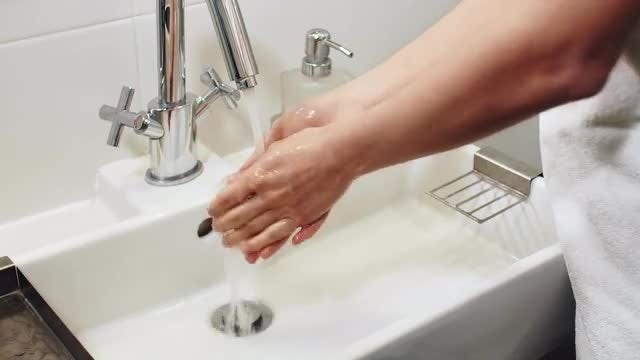 Washing Hands In The Sink: Stock Video