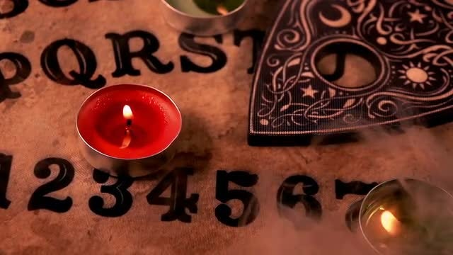 Candlelit Ouija Board: Stock Video