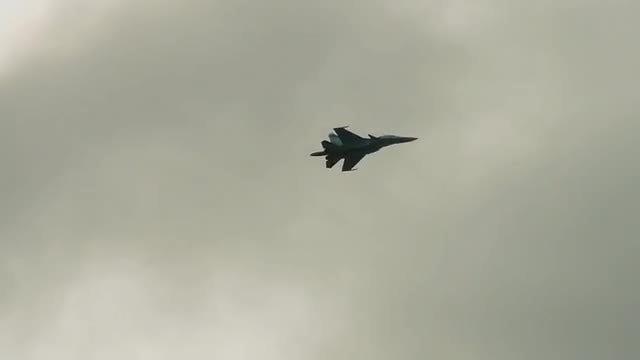 Fighter Jet On Cloudy Sky: Stock Video