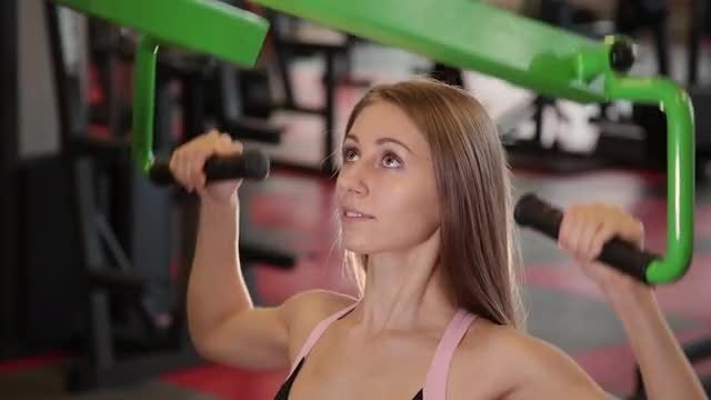 Girl On Machine At Gym: Stock Video
