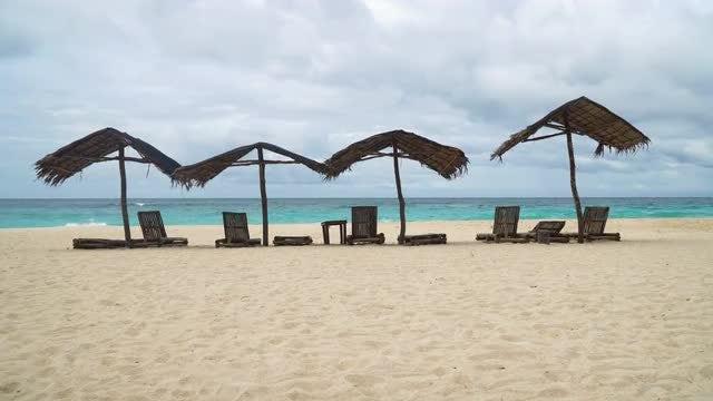 Cabanas On Tropical Island: Stock Video