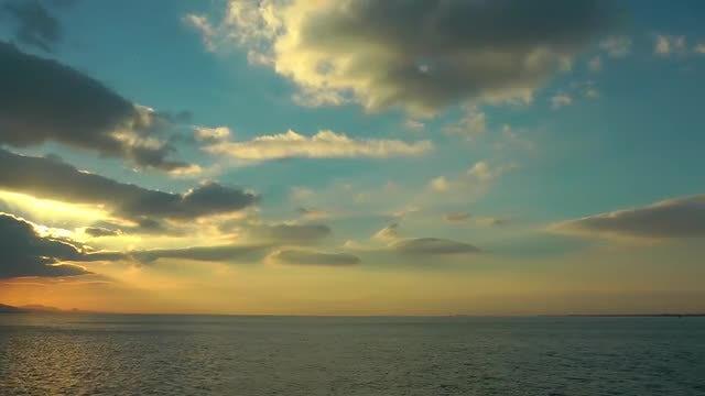 Cloudy Ocean Sunset: Stock Video