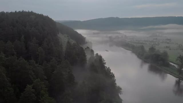 Aerial Over Hills And River: Stock Video