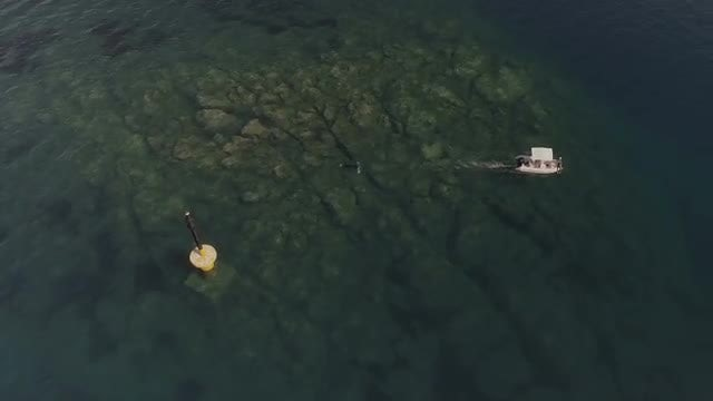 Small Boat Pulls Diver: Stock Video