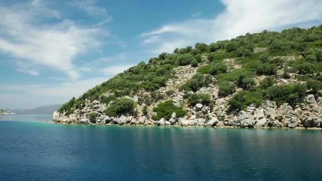White Stone Island In The Blue Sea: Stock Video