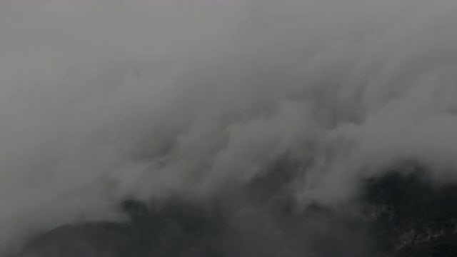 Mountain Covered In Fog: Stock Video