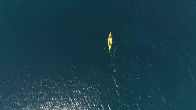 Yellow Kayak At Sea: Stock Video