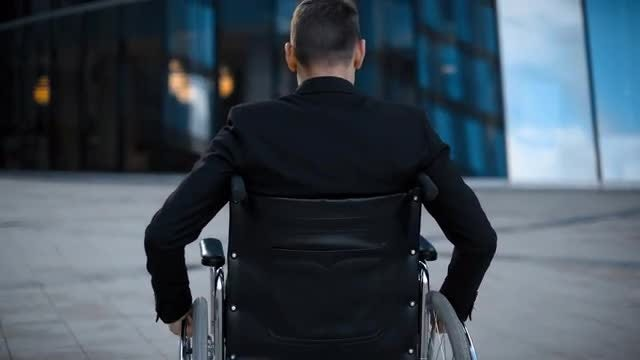 Handicapped Businessman Portrait: Stock Video
